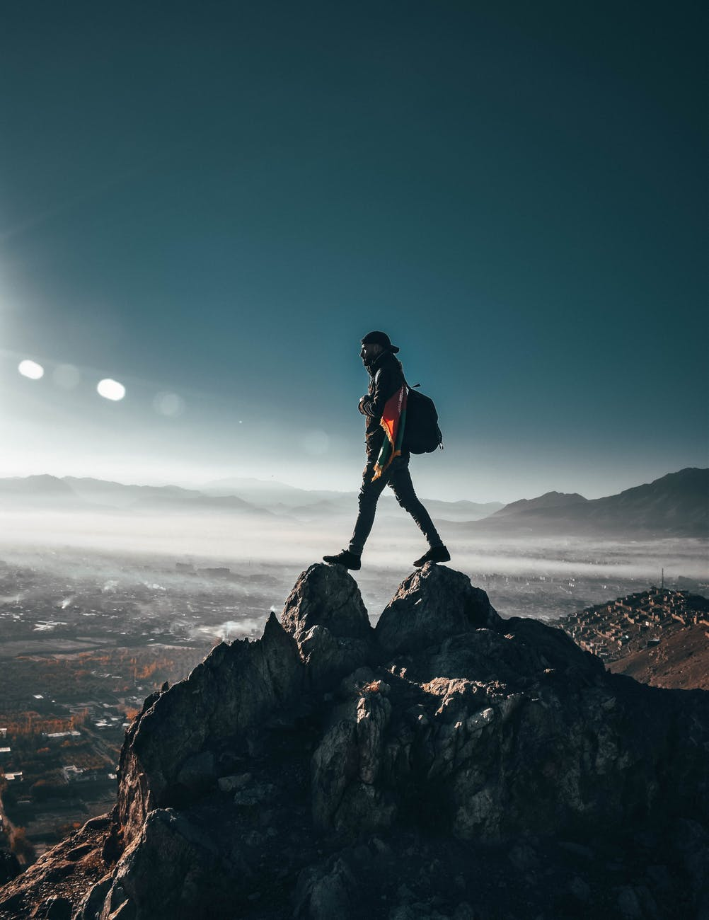 person standing on top of rock