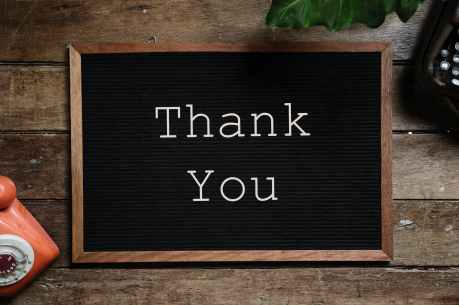 thank you text on black and brown board